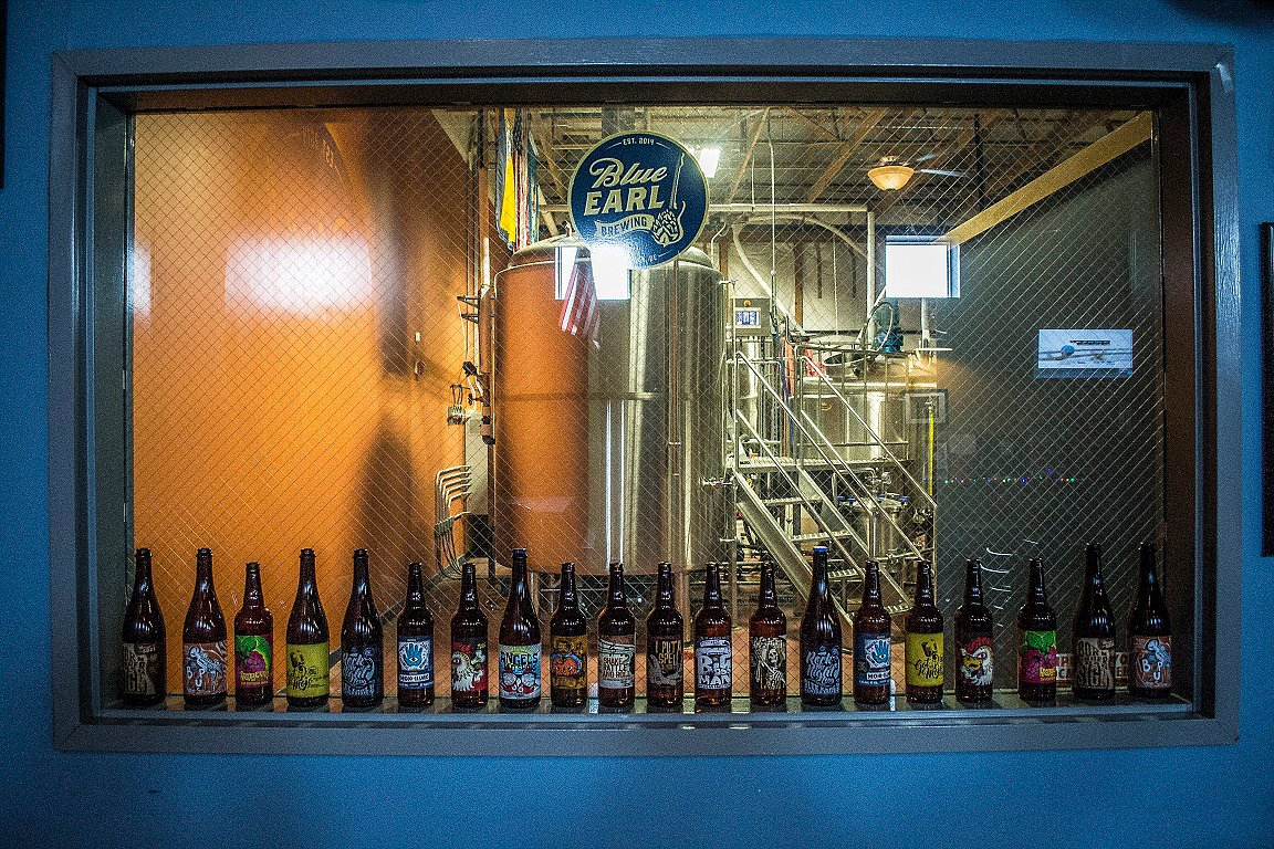 A large lineup of lovely bottled Blue Earl beer.